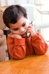 A child talking on the cellphone
