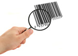 hand with magnifying glass scanning bar code (bar code is FAKE) poster