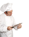 A male chef testing the sharpness of his knife blade poster