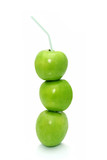 Granny Smith apples in a stack, with a straw.   poster