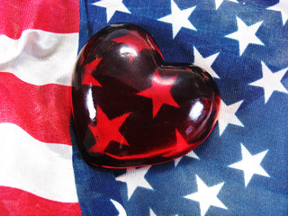 glass heart on American USA flag red white and blue
