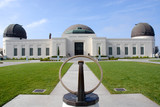 Newly renovated Griffith Observatory with sun dial in foreground poster