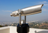 coin operated telescope overlooking city poster