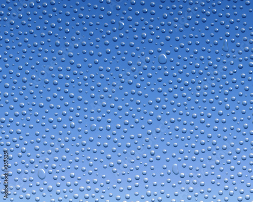 canvas print picture Water condensation formed on glass over a blue background