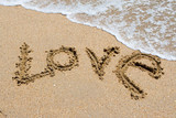 I love you written in the sandy beach. poster