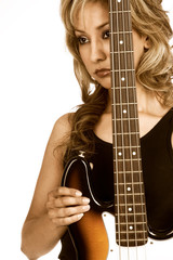 Portrait of Attractive Girl with electric bass guitar