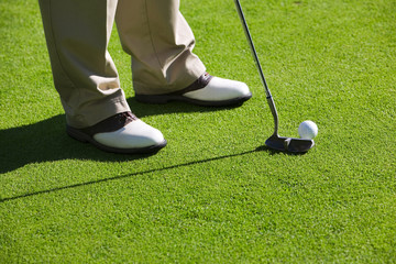 Close-up of man playing golf