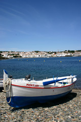 Beached rowing boat, a peaceful scene in a Spanish fishing port