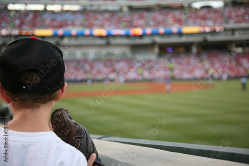 canvas print picture Young baseball fan watches the major league baseball game