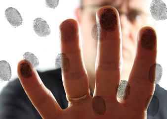 Man leaving fingerprints on glass.