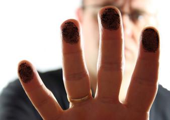 Man Presing on Glass leaving fingerprints.