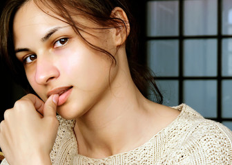 Young woman with inquiring stare