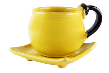 set of yellow cup and saucer