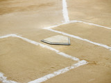 Home plate and chalk lines on a baseball diamond poster