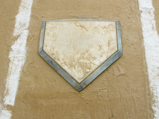 Close-up of home plate on a municipal baseball diamond