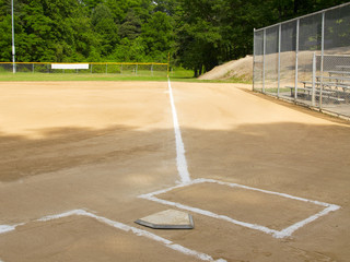 Home plate and first base foul line on a small-town ball diamond