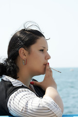 The girl with a cigarette on quay