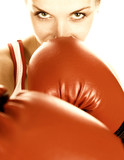 Sepia toned portrait of a girl with red boxing gloves - 3589817