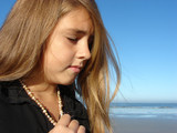 Young girl on the beach, Head & Shoulders shot with jewellery poster