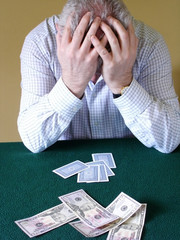 Card Player with Head Held in Hands