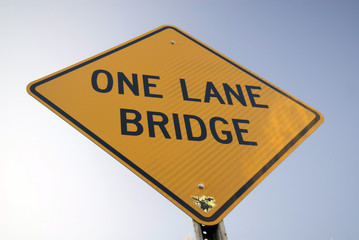 One Lane Bridge Sign near a Covered Bridge