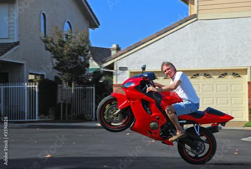 Leinwandbild Motiv Wheelie on Motorcycle
