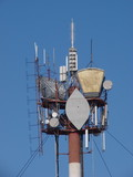 The peak of communication mast with lights and antennas poster