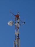 The peak of communication Hi-Tek mast with lights and antennas poster
