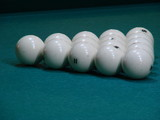 White balls on green textile pool table poster