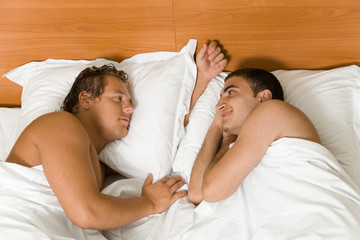 A homosexual couple in the bed room