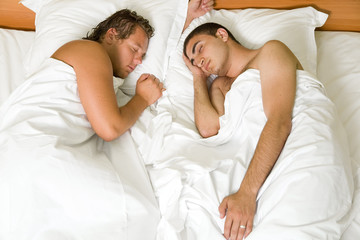 A homosexual couple sleeping in the bed