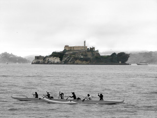 Alcatraz Island with a  kayak in front of it, view from Pier 39