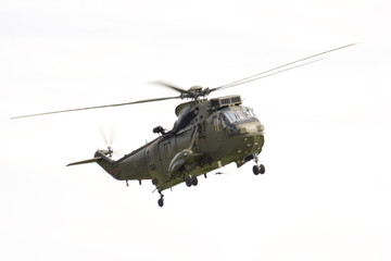 A Sea King Helicopter against a white background.