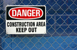 Danger construction area sign on site fence poster