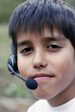 Young boy with phone headset poster