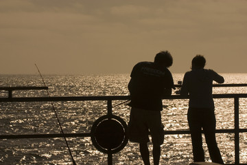 Couple fishing at the pier 2