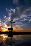Ranch Windmill Reflected in Farm Pond, Silhouetted Sunset poster