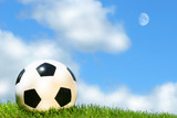 Soccerball against a blue sky poster