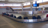 suitcases and bags at the airport luggage carousel poster
