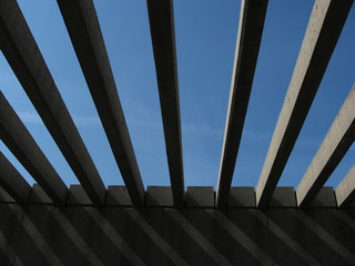 concrete beams open to blue sky.