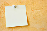 Single blank note paper attached to a wall poster