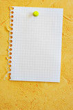 Single blank sheet attached to a yellow wall poster