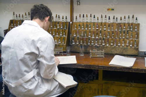 poster of Student in the chemical laboratory