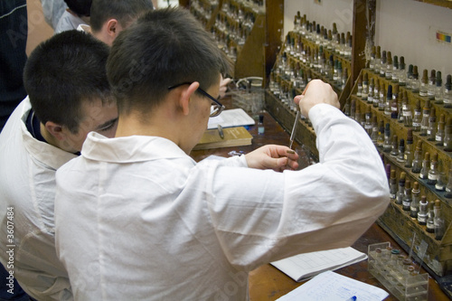 poster of Students in the chemical laboratory