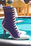 A pair of high heel tennis shoes poster