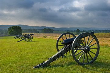 Morning storm clouds over a row of cannon