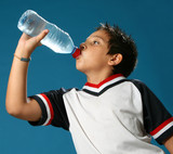 Thirsty boy drinking fresh water wearing sport clothes poster
