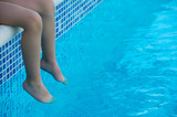 feet refreshing in swimming pool in summer poster