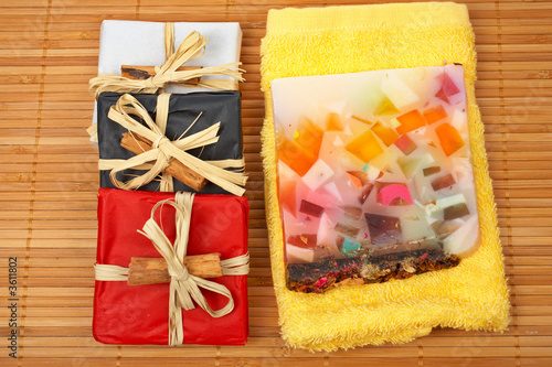 Three gifts and fruit soap on yellow towel.  Shallow DOF