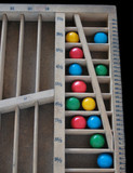 gumballs in a wood rule case